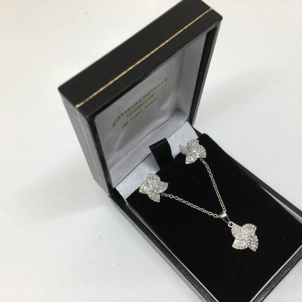 9 carat white gold diamond pendant and earring set