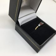 9 carat yellow gold garnet and CZ 3 stone ring