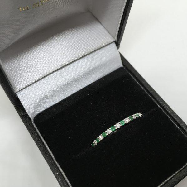 9 carat white gold emerald and diamond 1/2 eternity ring