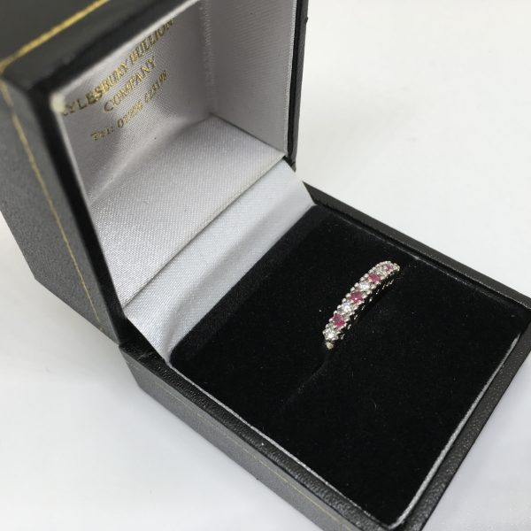 9 carat white gold ruby and diamond 1/2 eternity ring