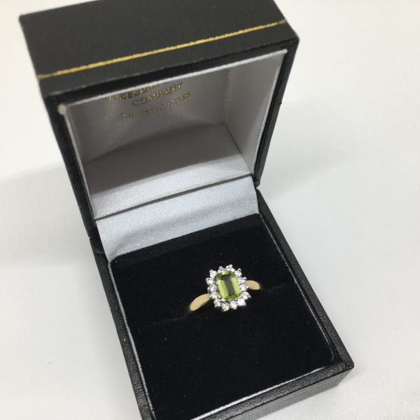 9 carat yellow gold peridot and CZ cluster ring