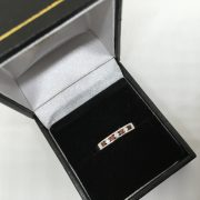 9 carat white gold garnet and diamond 1/2 eternity ring