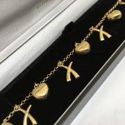 9 carat yellow gold 'heart' and 'kiss' bracelet