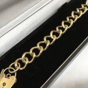 9 carat yellow gold heavy charm bracelet