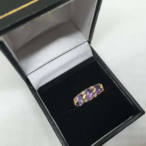 9 carat yellow gold amethyst and CZ ring