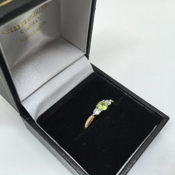 9 carat yellow gold peridot and CZ 3 stone ring