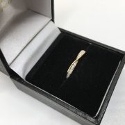 18 carat yellow gold diamond crossover ring