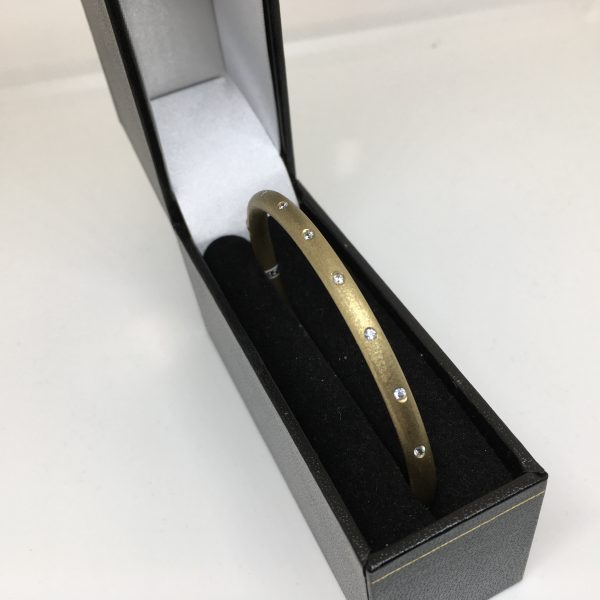 9 carat yellow gold CZ bangle