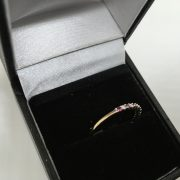 9 carat yellow gold ruby and diamond 1/2 eternity ring