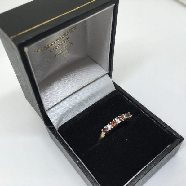 9 carat yellow gold garnet and CZ eternity ring