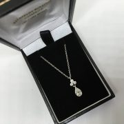 18 carat white gold diamond teardrop pendant and chain