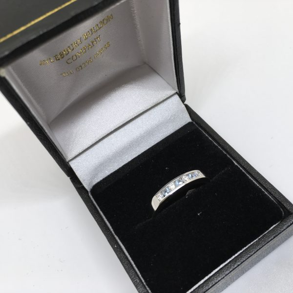 9 carat blue topaz and diamond 1/2 eternity ring