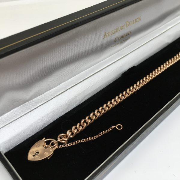 9 carat rose gold charm bracelet