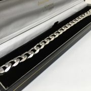 9 carat white gold beveled edge flat curb bracelet