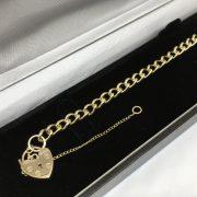 9 carat yellow gold charm bracelet