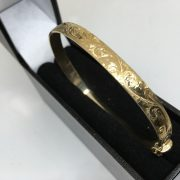9 carat yellow gold engraved bangle
