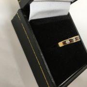 9 carat garnet and diamond 1/2 eternity ring