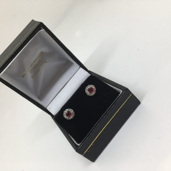 18 carat white gold ruby and diamond earrings