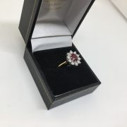 18 carat yellow gold ruby and diamond cluster ring
