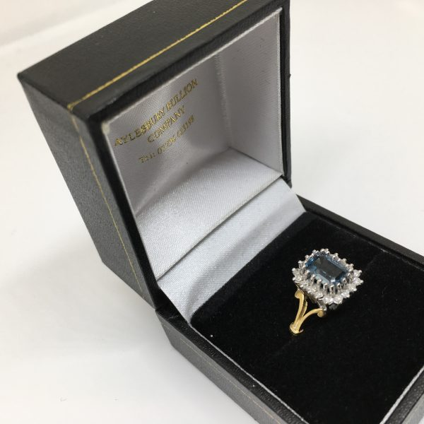 Preowned 18 carat yellow gold blue topaz and diamond ring