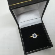 18 carat yellow gold sapphire and diamond cluster ring