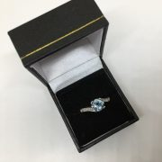 Preowned 18 carat white gold topaz and diamond ring