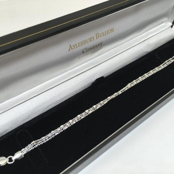 Silver 3 strand beaded bracelet