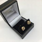 9 carat yellow gold knot studs