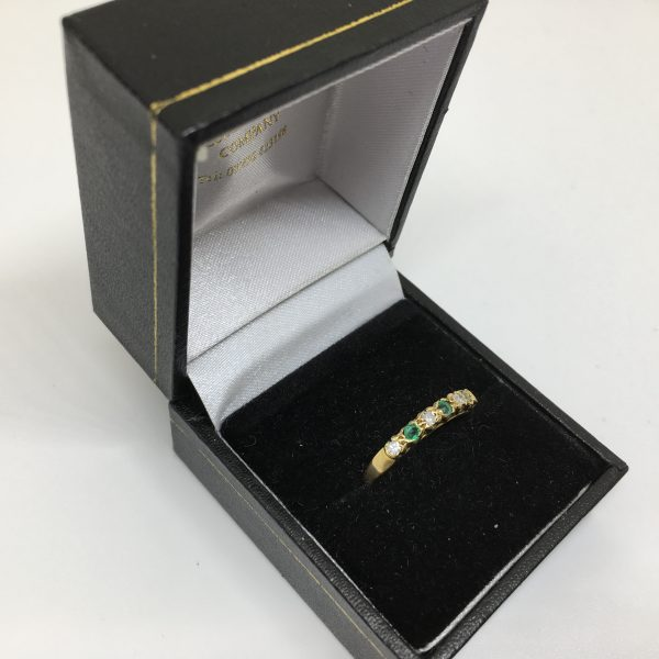 Preowned 18 carat yellow gold emerald and diamond ring