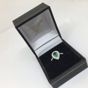 18 carat white gold emerald and diamond ring