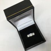 Preowned platinum and diamond 3 stone ring