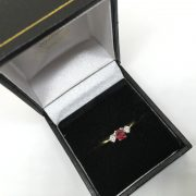 Preowned 18 carat yellow gold ruby and diamond ring