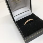 18 carat yellow gold ruby and diamond band/ eternity ring