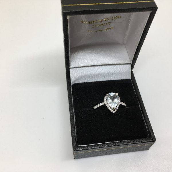 Platinum aqua marine and diamond halo style ring