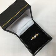 Preowned 18 carat 2 colour diamond single stone ring