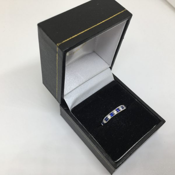 18 carat white gold sapphire and diamond band/ eternity ring