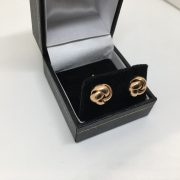9 carat rose gold knot studs
