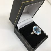 Preowned 18 carat white gold blue topaz and diamond ring