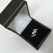 Preowned 14 carat yellow gold diamond crossover ring