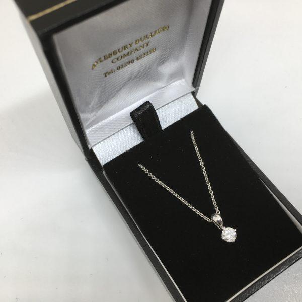 Platinum and diamond single stone pendant and chain