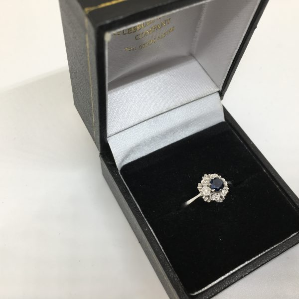 Preowned 9 carat white gold sapphire and diamond cluster ring