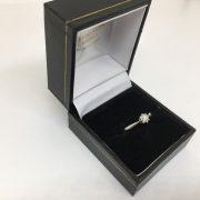 Preowned platinum single stone diamond star burst ring