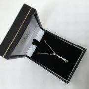 18 carat white gold emerald and diamond pendant and chain
