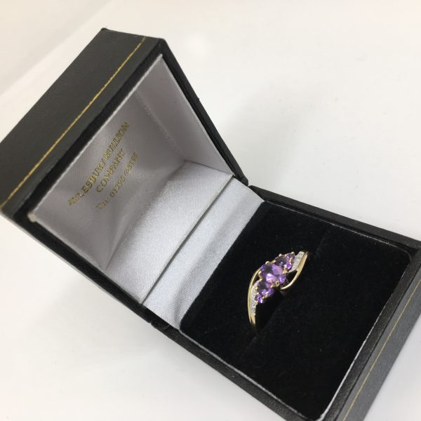 Preowned 9 carat yellow gold amethyst and diamond ring