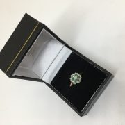 Preowned 9 carat yellow gold emerald and diamond ring