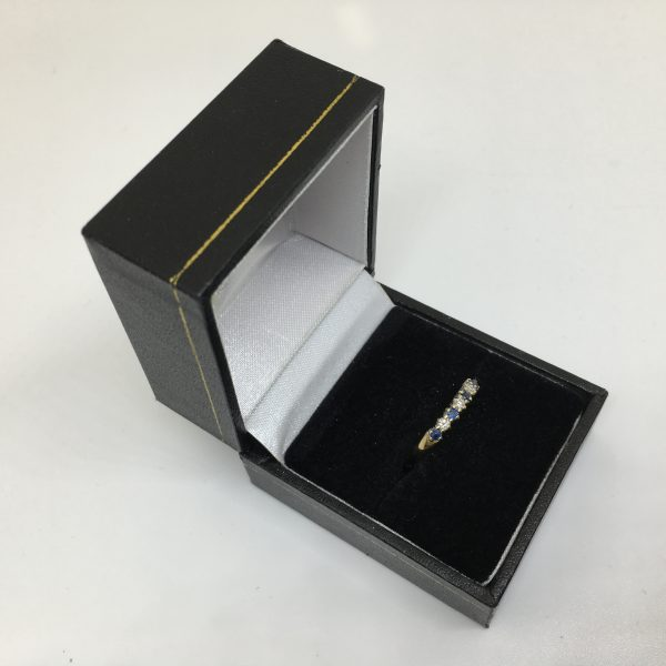 Preowned 9 carat yellow gold sapphire and diamond ring