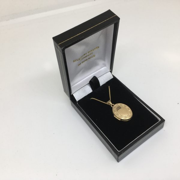 9 carat yellow gold oval locket and chain