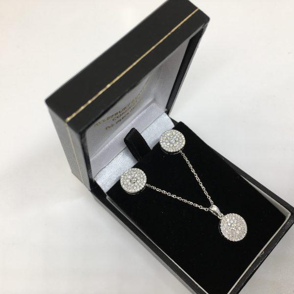 18 carat white gold diamond earring and pendant set