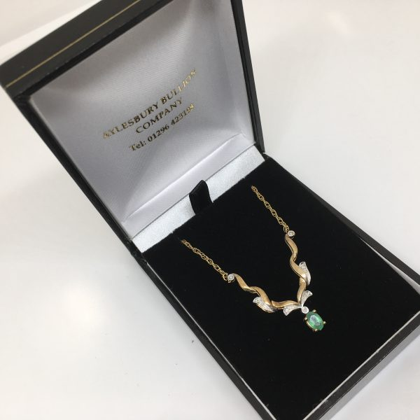 Preowned 9 carat yellow gold emerald and diamond necklace