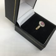 Preowned 9 carat yellow gold ruby and diamond cluster ring